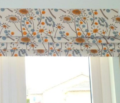 Blackout lined blue, orange print roman blind in a Fife bedroom
