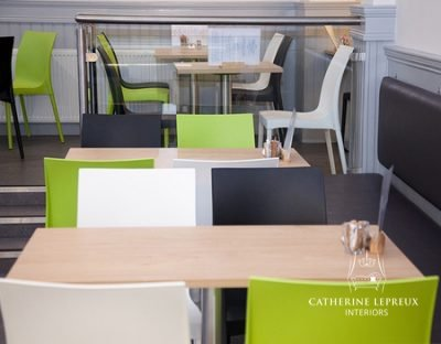 Grey and lime green seating in a contemporary Edinburgh cafe
