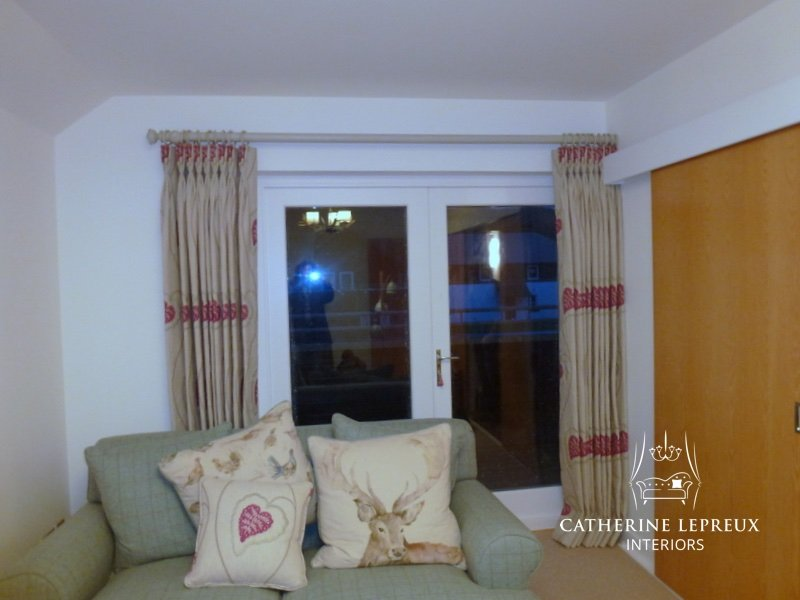 Interlined curtains hung at patio doors in Perth Scotland. Pleated to pattern