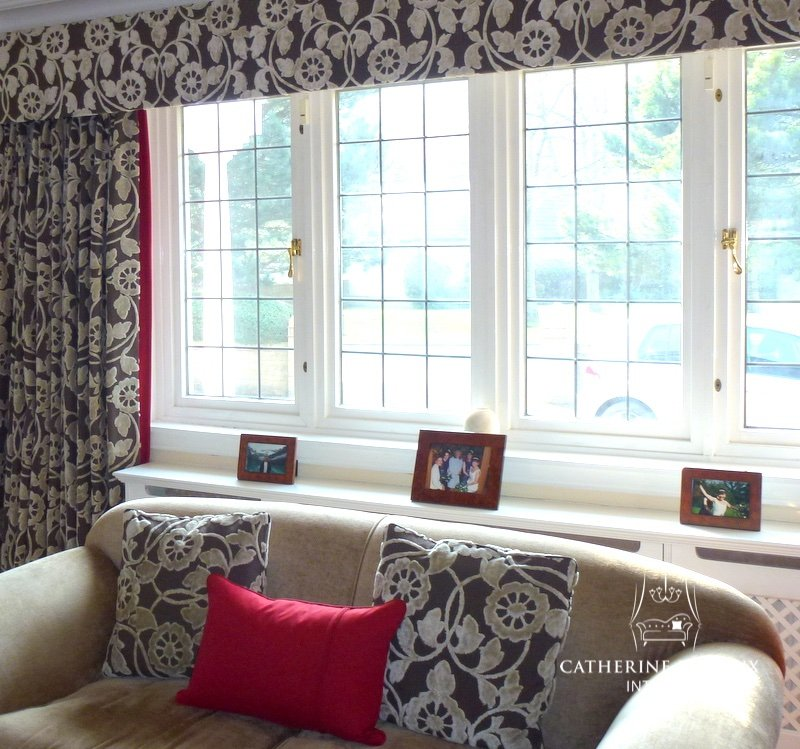 interior design embossed taupe velvet interlined curtains and pelmet with a red contrast border in an Edinburgh living room