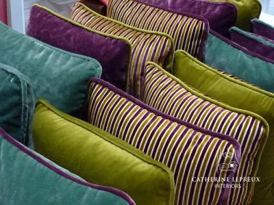 interior design purple, lime green and teal velvet cushions
