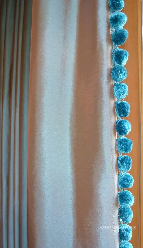 Teal bobble trimmings on leading edge of grey silk interlined curtains