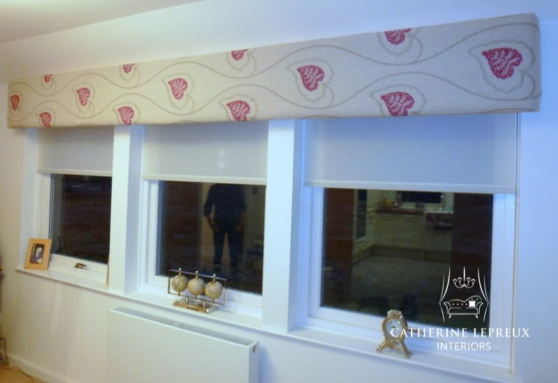 soft furnishings upholstered pelmet with semi sheer roller blinds in a Perth steading conversion. Fabric is Villa Nova embroidered linen