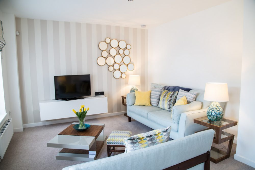 interior design-contemporary Edinburgh living room neutral duck egg yellow decor with sofas by Charlotte James